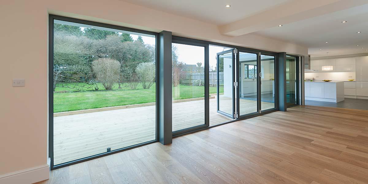 Grey bi folding doors aluminium windows bi folding for 5 star windows and doors